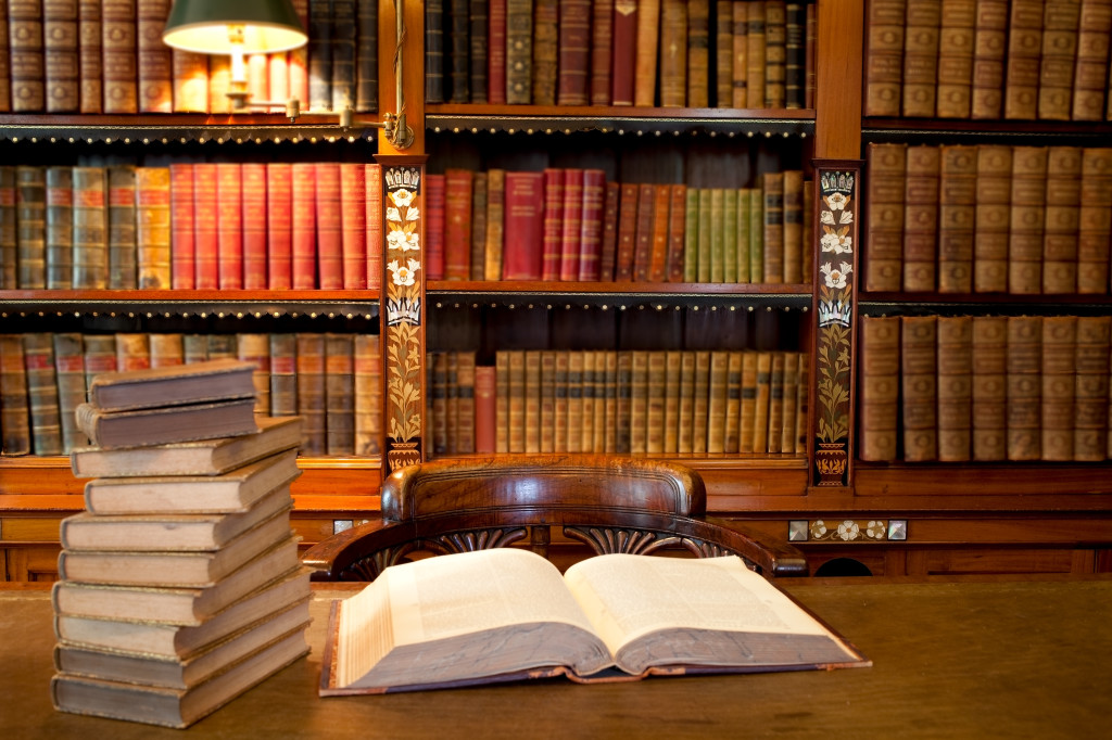 Old classic library with books on table